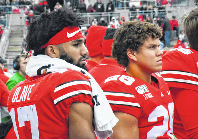 Chris Olave and Amari McMahon stand on the sideline during the third quarter of Ohio State's game against Maryland on Nov. 9.