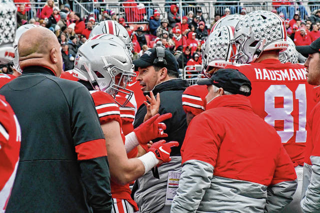 Ohio State head football coach Ryan Day talks to his offense during a timeout in a game against Maryland on Nov. 9.