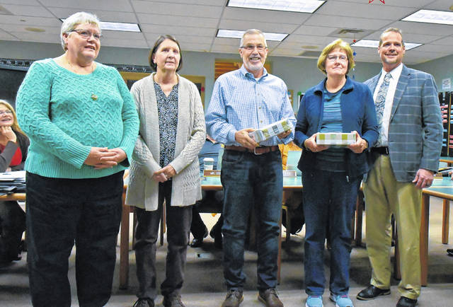During the Buckeye Valley Board of Education meeting Wednesday, four retirees were honored for their service to the district. Pictured, left to right, are Ann Rammelsburg, Pat Tuggle, Mark Malcolm, Sharon Baxter and Superintendent Andrew Miller.