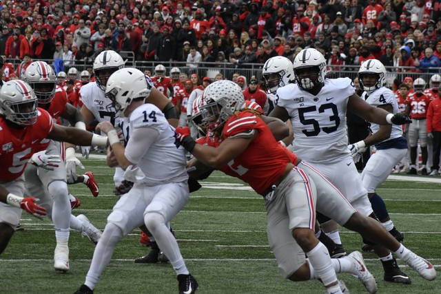 Ohio State defensive end Chase Young sacks Penn State quarterback Sean Clifford in the first half.