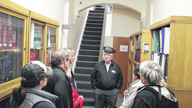 Delaware County Historical Society volunteer Brent Carson leads a group of people on a tour of the old Delaware County Jail and Sheriff's Residence at 20 W. Central Ave., Delaware.