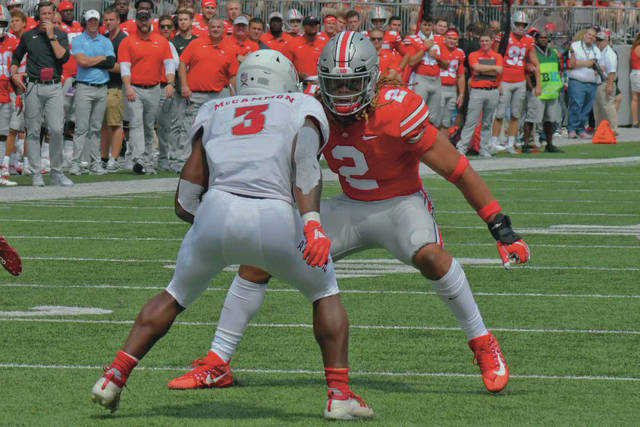 Ohio State defensive end Chase Young sizes up a running back during their game against Florida Atlantic in August.