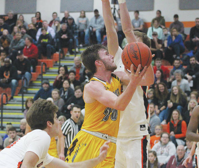 Buckeye Valley's Troy Scowden puts up a shot between Hayes' Addison Harvey, left, and Paul Burris during the second half of Friday's season opener in Delaware.