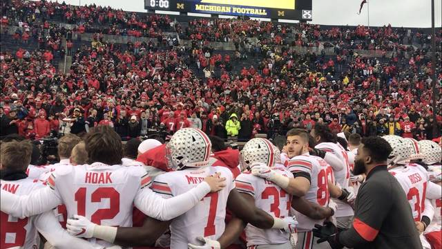 Ohio State players sing Carmen Ohio with the thousands of fans who made the trip to Ann Arbor to see the Buckeyes' 56-27 win over Michigan.