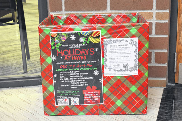 Donation boxes like this are placed throughout Hayes High School encouraging students to donate new toys to People In Need, Inc. of Delaware County. Hayes will hold a holiday event Saturday afternoon that will feature three movies, crafts, food, and a performance by Hayes Singers.