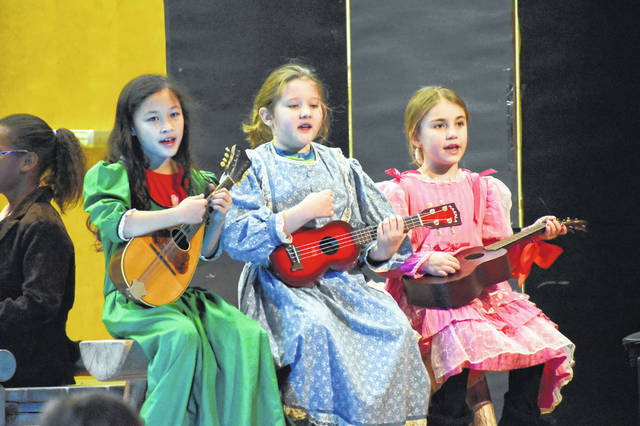 Three Smith students sing a musical number Wednesday afternoon during the performance. All of the dialog was written by students, and the songs were written by Sheela Das, artistic director of Creative Concepts in Music.