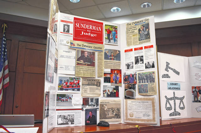 Several posterboards were on display during the party and showed Sunderman before and during his time as judge, a position he has held since January 2002. He did not seek re-election this year and will be followed Kyle Rohrer, who will be sworn in Friday.