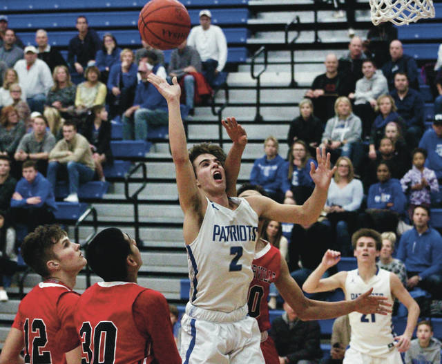 Liberty's Henry Hinkle (2) puts up a floater during the first half of Thursday's league showdown against visiting Westerville South.