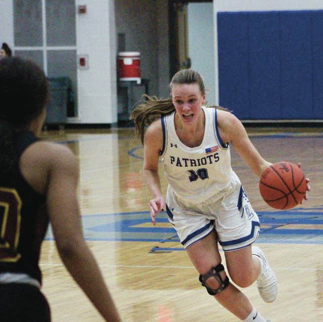 Olentangy Liberty's Teegan Pifher drives toward the hoop during the first half of Friday's showdown against visiting Westerville North.