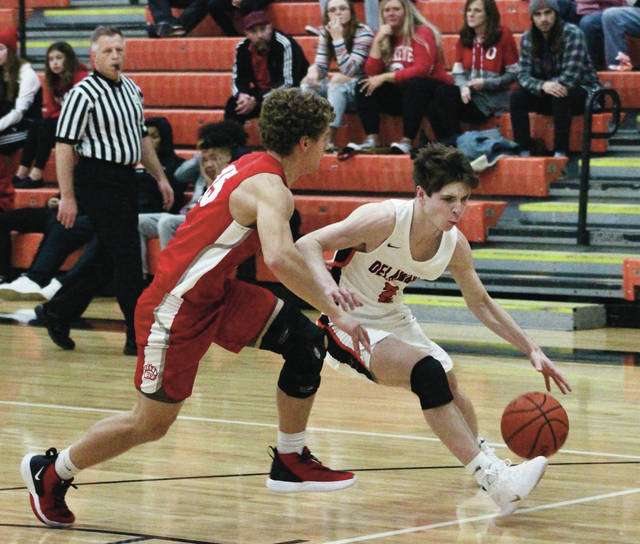 Hayes' Nate Griggs, right, drives past a Wadsworth defender during the first half of Saturday's non-league showdown in Delaware.