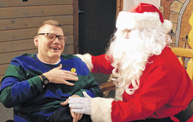 Chad Maddrix's face lit up with joy as he spoke with Santa Claus at Recreation Unlimited's annual Camper Holiday Party Dec. 8.