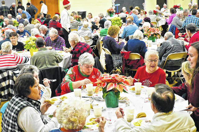 Generations crossed paths as Buckeye Valley High School students welcomed 300 grandparents, aunts, uncles and senior citizens from the Buckeye community to the annual Senior Citizen Day on Friday. After a musical concert in the high school auditorium, seniors were served a luncheon by the Student Council in the auxiliary gym.