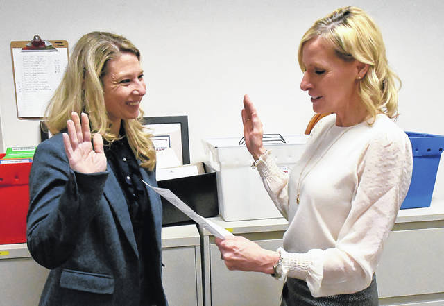 Before the recount began in the Powell City Council race, Nicole Scott, left, was sworn in as an official observer by Delaware County Board of Elections Director Karla Herron.
