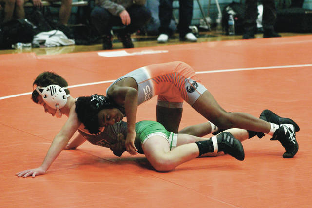 Hayes' Maurice Avant wrestles Dublin Scioto's Quinn Kahkonen during Thursday's OCC dual in Delaware.