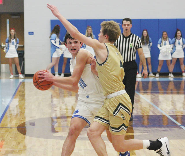 Olentangy Berlin's Jason Inbody, left, brings the ball up the court against Dublin Jerome's Lachlan Macdonald during the first half of Friday's OCC showdown in Delaware.