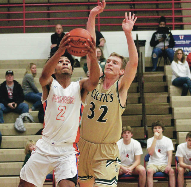 Olentangy Orange's Jason Foster puts up a shot in front of Dublin Jerome's Max Hanneman (32) during the first half of the opening game of the Stephen Gussler Invitational Friday afternoon at Thomas Worthington.