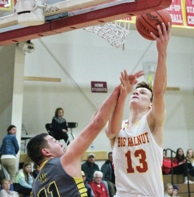 Big Walnut's Caleb Conard (13) soars toward the hoop during the first half of Wednesday's non-league showdown against visiting Watkins Memorial.