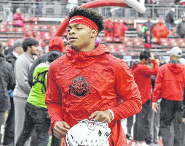 Quarterback Justin Fields heads back into the locker room ahead of Ohio State's game against Wisconsin on Oct. 26.