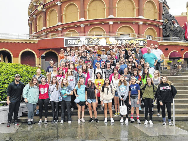 Members of the Delaware Hayes High School Grand Pacer Marching Band pose for a photo together on New Year's Eve in Tampa, Florida. The band went to Universal Studios, spent a day at the beach, and visited Busch Gardens.