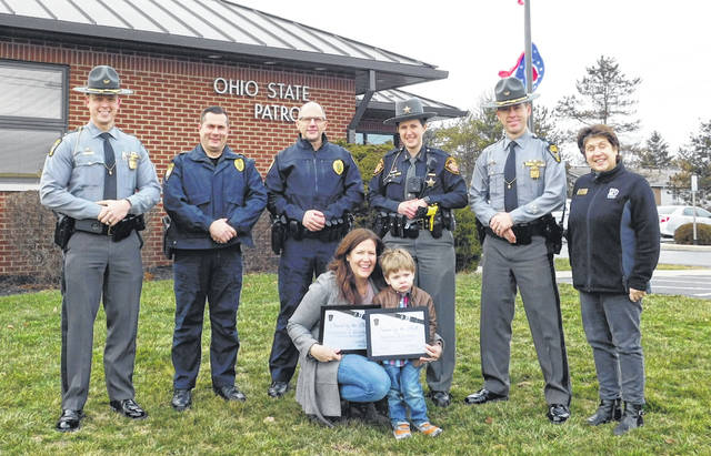 "Lewis Center residents Colleen A. Restivo and her son, Austin Restivo, recently accepted their ""Saved by the Belt"" certificates during a ceremony held at the Delaware Post of the Ohio State Highway Patrol."