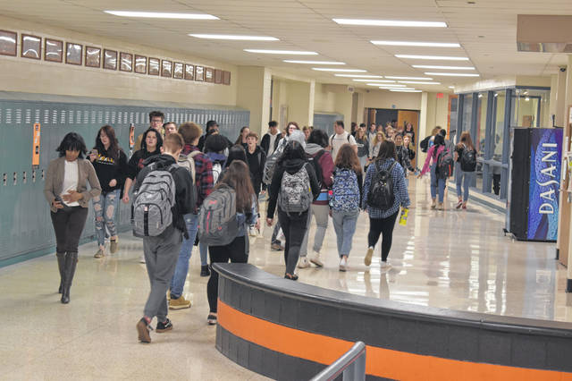 Students at Hayes High School walk to their classes Monday, the first day of the new semester.