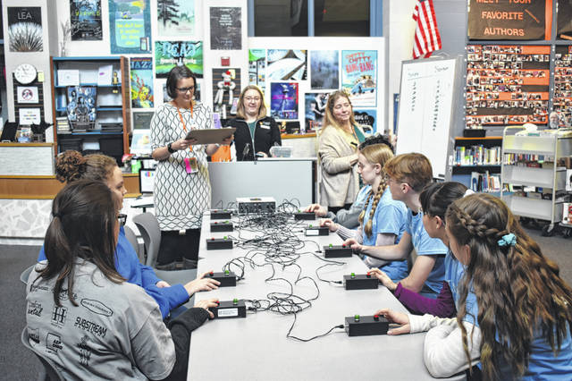 Battle of the Books teams from Fairview (left) and Steamtown (right) compete Monday morning to see which team remembered more about the preselected books as part of the competition. Sarah Ressler (top left), the librarian at Hayes, reads questions to one team at a time.