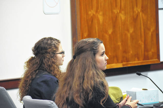 Hayes High School team attorneys Isabel Crissinger and Holly Hornberger listen to feedback from former Delaware Municipal Court Judge David Sunderman Friday. Sunderman was one of many local attorneys and judges to preside over the fictional courtrooms.