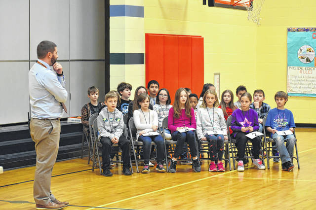 Conger Principal Josh Page explains the rules of the spelling bee to students at Conger Elementary School Thursday.