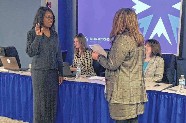 Olentangy Treasurer Emily Hatfield swears in new Olentangy Board of Education member LaKesha Wyse, left, during Thursday's meeting.