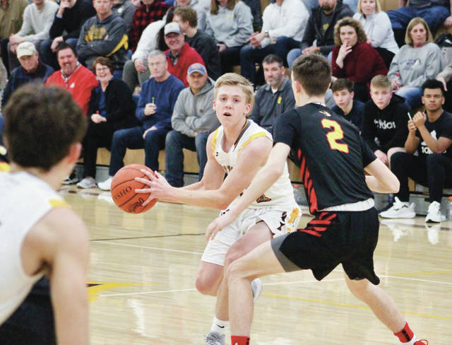 Buckeye Valley's Owen Osborne looks for an open teammate during a game earlier this season.