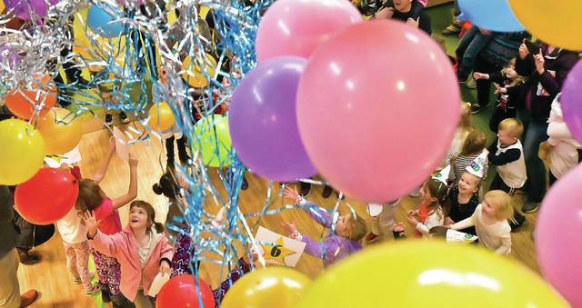 With the release of the balloons Tuesday at noon during the Noon Year's Eve party at the main branch of the Delaware County District Library, the squeaks, squawks, and screams of children echoed around the library.