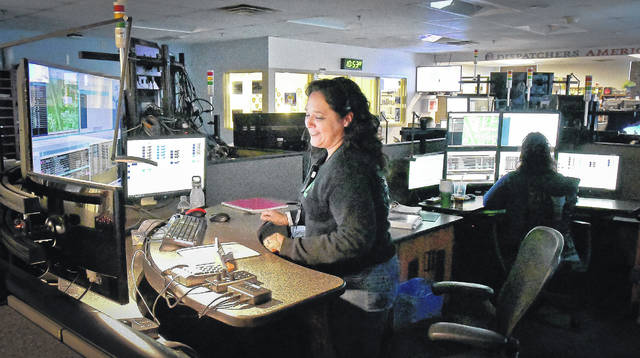 Dispatcher Kim Curren Romero monitors calls and dispatches at her station deep in the heart of the Delaware County Emergency Communications 911 Center. Romero has been a dispatcher with the 911 center since 2006.
