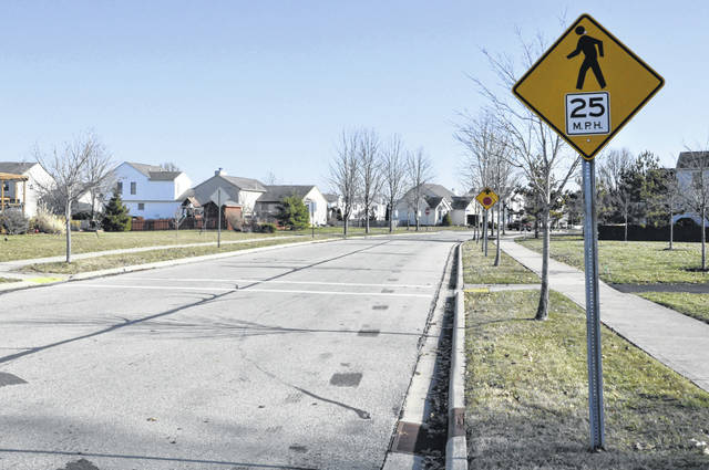 As part of a 12-month traffic calming pilot program approved Monday by Delaware City Council, pavement markings such as centerline and edge line striping will be installed this spring on Cobblestone Drive and Carson Farms Boulevard. Pictured is a stretch of Cobblestone Drive just before it intersects with Carson Farms Boulevard and Hayfield Drive.