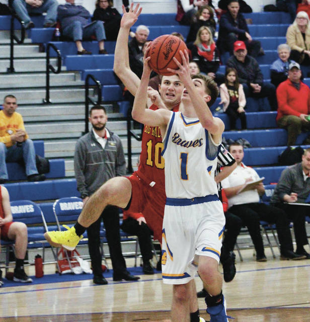 Olentangy's Jake Elmore (1) races Big Walnut's Jacob Krous (10) down the floor for a layup during the first half of Tuesday's non-league showdown in Lewis Center.