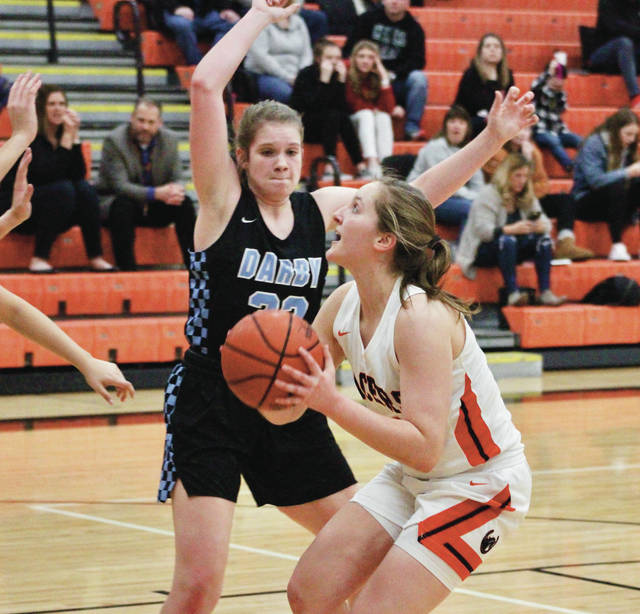Hayes' Chloe Jeffers goes to work against Hilliard Darby's Ashley Powers, back, in the first half of Friday's OCC showdown in Delaware.