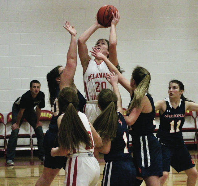 Delaware Christian's Lyssi Snouffer (20) puts up a contested shot in the lane during the first half of Thursday's league showdown against visiting Shekinah Christian.