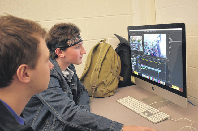 Gianni Cordi and Brandon Schrader, seniors at Hayes High School, look over the final cut of their documentary about President Rutherford B. Hayes that will premiere Monday afternoon.