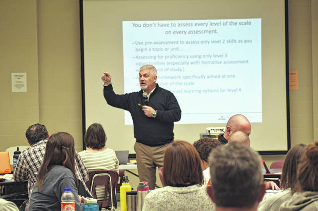 Dr. Phil Warrick speaks to Delaware City Schools teachers Friday afternoon during the district's professional developlment day at Hayes High School.
