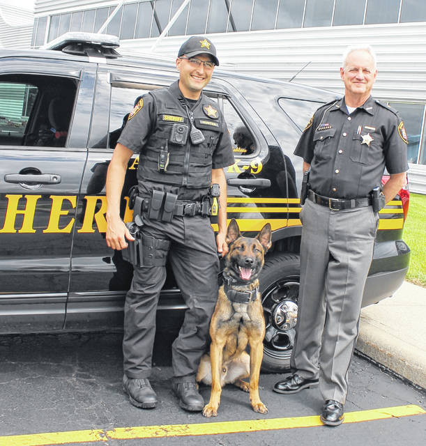 Kahless, a member of the Delaware County Sheriff's Office K9 Unit, will receive a bullet and stab protective vest thanks to a donation from Vested Interest in K9s, Inc. Pictured alongside Kahless is his handler, Deputy Brandon Hunter (left), and Sheriff Russell Martin (right).