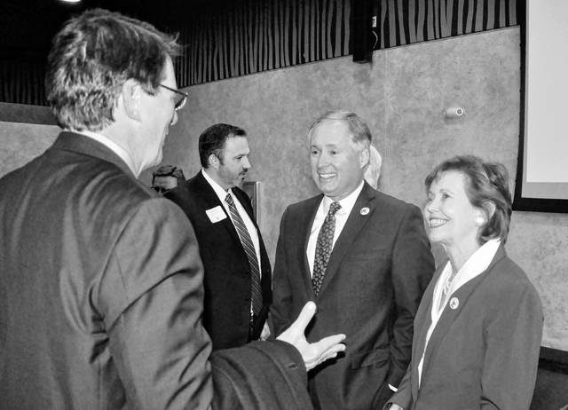 Delaware County commissioners Barb Lewis, right, and Jeff Benton, center, speak to Ohio Wesleyan University President Rock Jones following Tuesday's State of the County address held at the Columbus Zoo and Aquarium's Africa Event Center in Powell. Delaware County Common Pleas Court Judge James P. Schuck is pictured in the background.