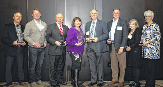 The Delaware Area Chamber of Commerce held its annual dinner Feb. 6 at the Hilton Columbus/Polaris. Pictured, left to right, are the following individuals honored by the chamber during the event: Dan Dillon, Swan Lake Event Center, Innovation in Business Award; Joe Wolfrum, Wolfrum Roofing & Exteriors, Large Business of the Year; Frank Hickman, Integrated Financial Network, Citizen of the Year; Ana Babiasz, Fidelity Federal Savings & Loan, Chamber Member of the Year; Jason Comstock, Clarity Technology Solutions, Small Business of the Year; Frank Reinhard, First Commonwealth Bank, Wayne Hilborn Lifetime Achievement Award; Dr. Jane Graebner, Foot & Ankle Wellness Center, Corporate Citizen of the Year; and Sue Hanson, HelpLine of Delaware & Morrow Counties, Quality of Life Award.
