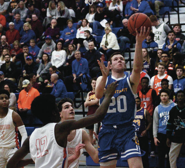 Olentangy's Austin Brown (20) soars toward the hoop for a layup during the first half of Friday's OCC showdown against host Olentangy Orange in Lewis Center.