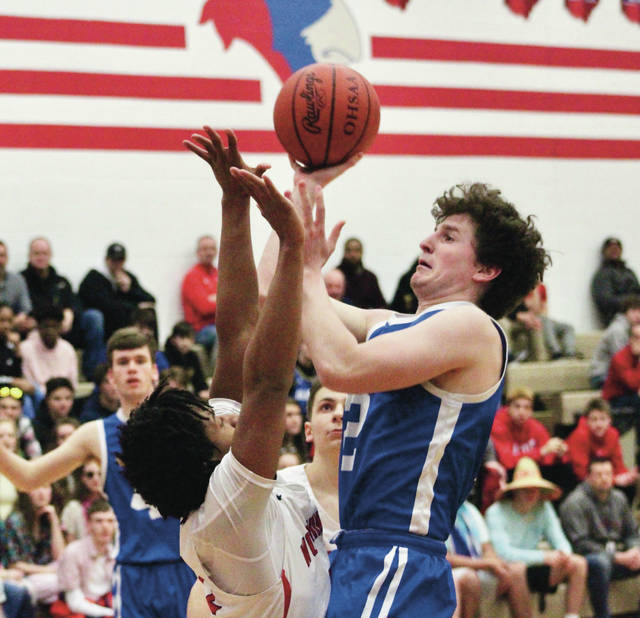 Olentangy's Josiah Seymour, right, puts up a shot during the first half of Friday's Division I district tournament game against host Thomas Worthington.