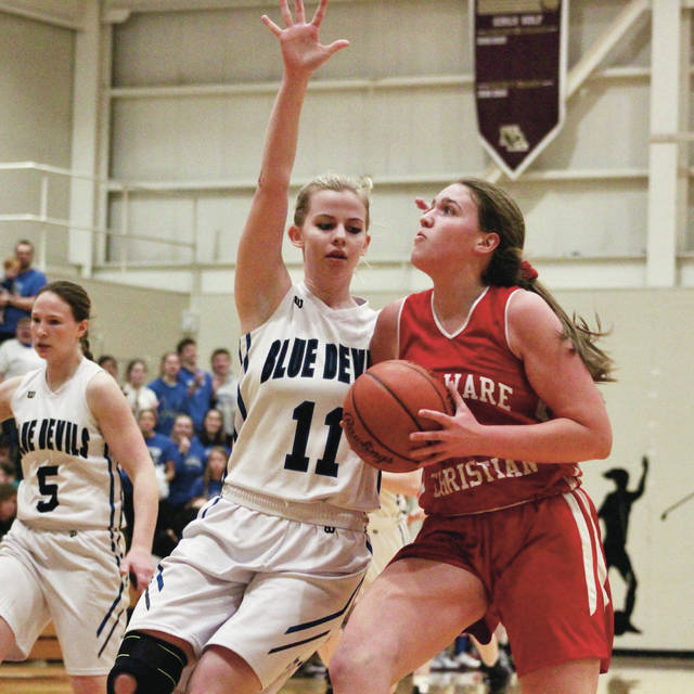 Delaware Christian's Katie Neuhart drives against Danville's Hannah Duncan (11) during the second half of Wednesday's Division IV district semifinal in New Albany.