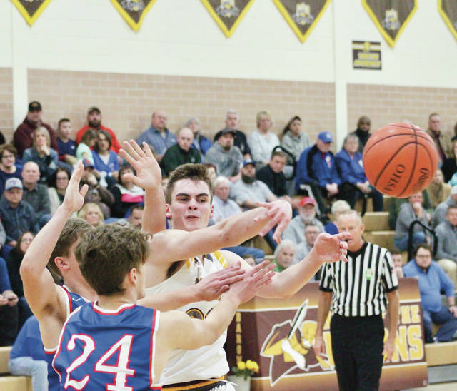 Buckeye Valley's Clark Newland, right, passes out of trouble during the first half of Tuesday's non-league showdown against visiting Highland.