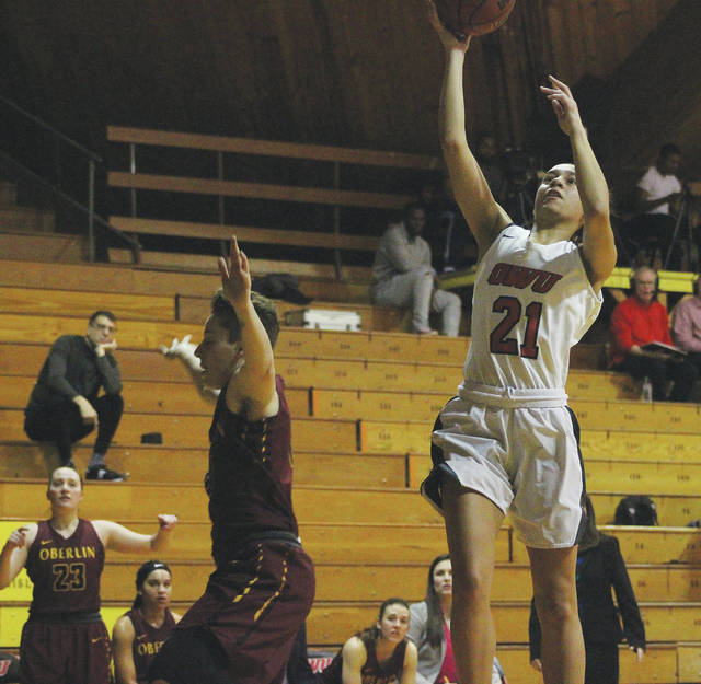 Ohio Wesleyan's Cierra Joiner (21) goes up for a layin during the first half of Wednesday's NCAC showdown against visiting Oberlin.