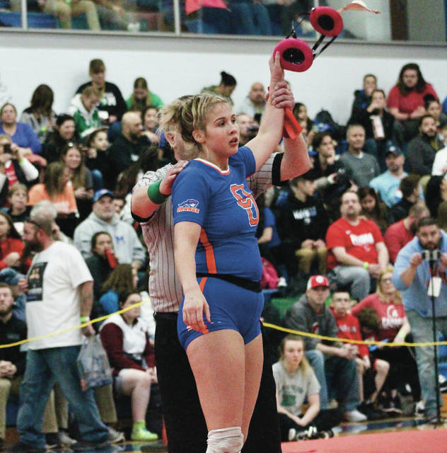Olentangy Orange's Taryn Martin gets her arm raised after picking up a win in the first round of the OSWCA Girls State Wrestling Tournament Saturday at Hilliard Davidson High School. She won all five of her matches to take the title in the 137-pound weight class.