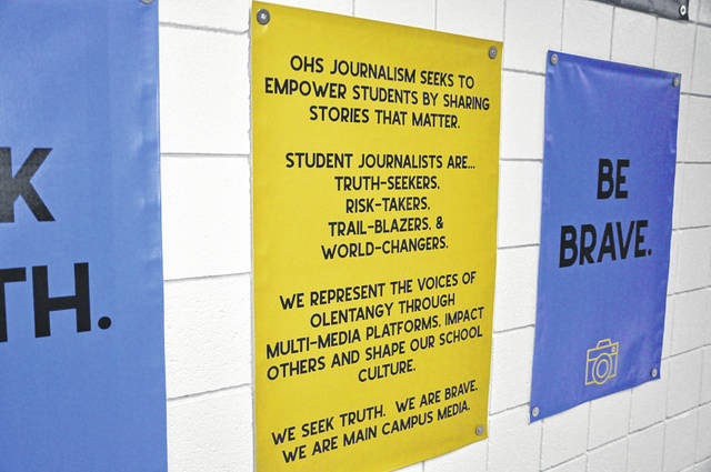 A banner displaying the creed of the journalism department hangs in the hallway of the OHS journalism wing.