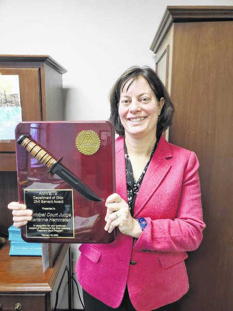 Delaware Municipal Court Judge Marianne Hemmeter stands in her office at Delaware Municipal Court with her Civil Servant Award from AMVETS. Hemmeter was presented the award on Feb. 15 and honored for her work in creating the Delaware Mission Court, a specialized docket for veterans who have pleaded guilty in nonviolent crimes.