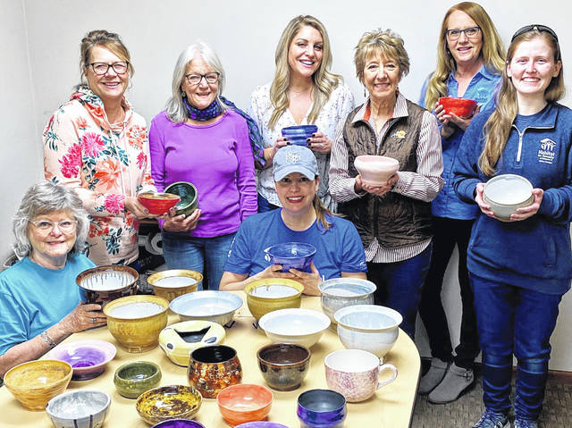 Pictured with some of the bowls that will be available on Tuesday, March 17, during Habitat for Humanity of Delaware & Union Counties' 18th annual Soups for Shelter event are members of the Soups for Shelter Committee.